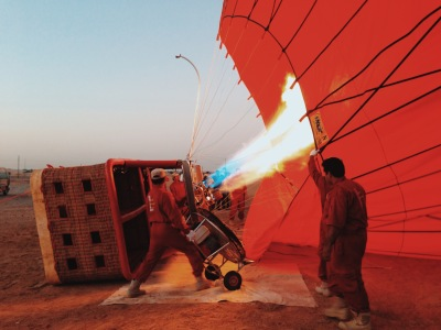 Hot air balloon being inflated in the Dubai desert