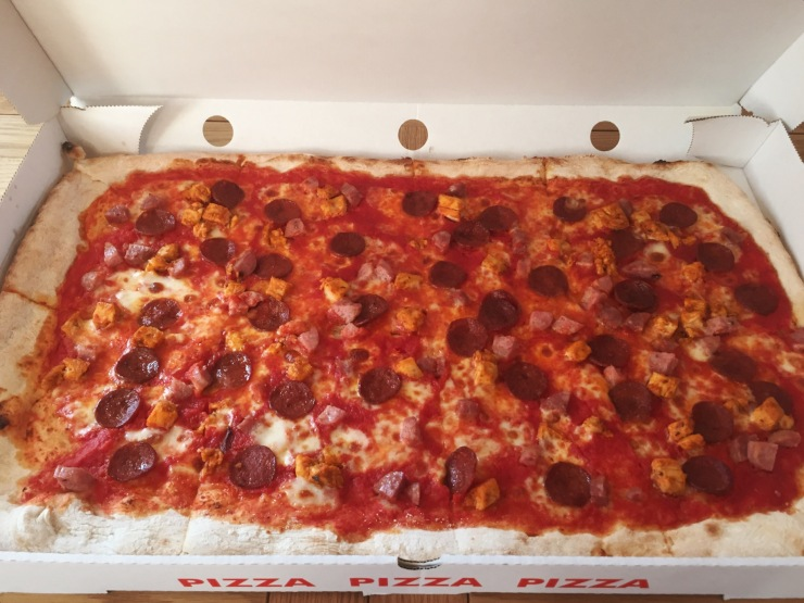 Twenty inch Rustica pizza with marinated chicken, sausage, mozzarella and pepperoni