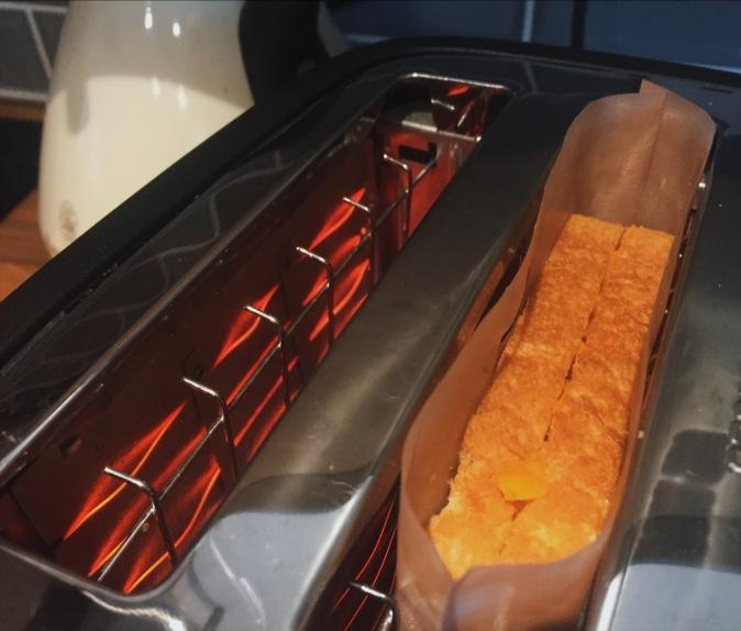 Cheese Postie toastie in the toaster