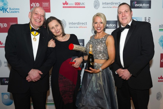 Francesca Skelton, Winner of the MKBAA Lifetime Achievement Award 2017, with host Gail Emms, Judge Sir John Southby Bt and award sponsor Jon Corbett of Barclays