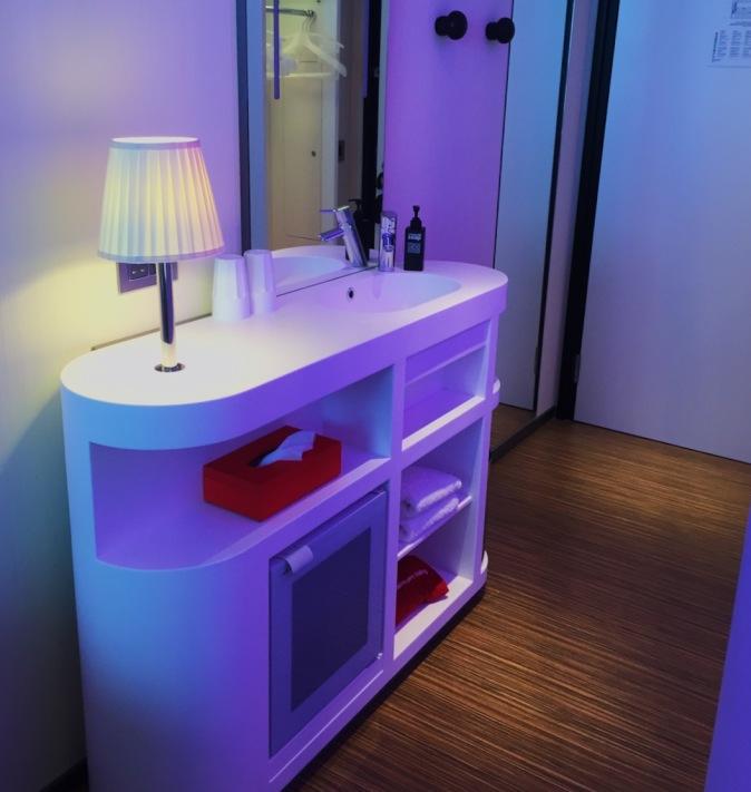 CitizenM hotel room wash basin and mini fridge
