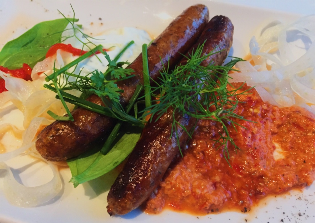 Grilled merguez sausages, muhammara, sumac raita at Oxo Tower